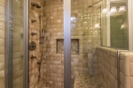Custom shower with seating and multiple shower heads