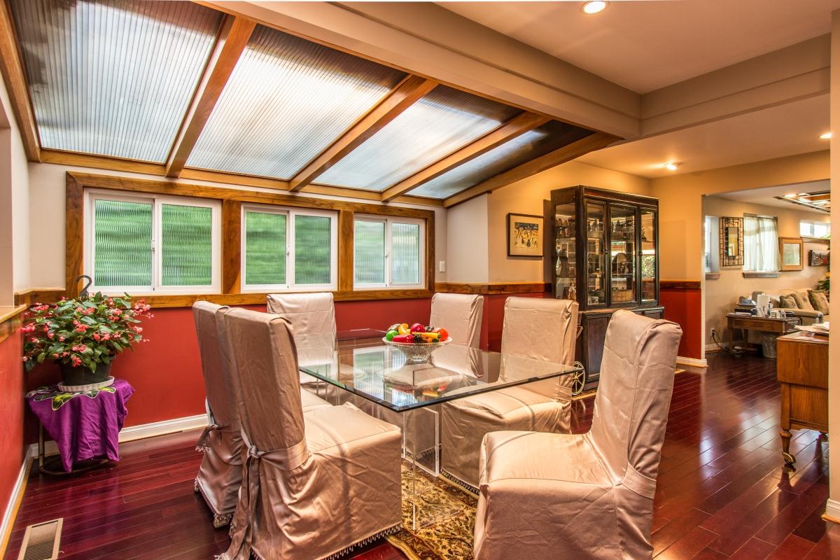 Stunning dining area with custom skylights & wood ceiling